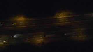 AX123_184 - 6K stock footage aerial video of a bird's eye view of cars on Southern State Parkway at Night in Massapequa, New York