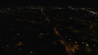 AX123_187 - 6K stock footage aerial video orbit Southern State Parkway and Carmans Road at Night in Farmingdale, New York