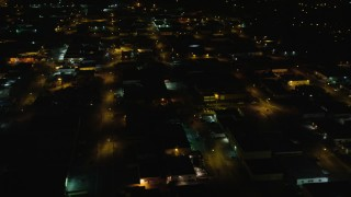 AX123_188 - 6K stock footage aerial video orbit warehouses at Night in Farmingdale, New York