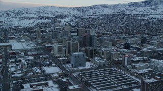 AX124_012 - 6K stock footage aerial video of Downtown Salt Lake City, Utah, at Sunrise in Winter