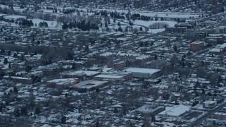 AX124_015 - 6K stock footage aerial video of Westminster College at Sunrise in Winter in Salt Lake City, Utah