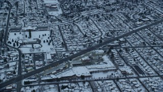 AX124_018 - 6K stock footage aerial video fly over strip mall and Salt Lake City neighborhoods at Sunrise in Winter in Utah
