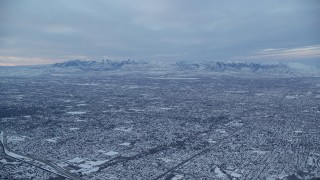 AX124_030 - 6K stock footage aerial video of Salt Lake City suburbs at Winter Sunrise in Utah