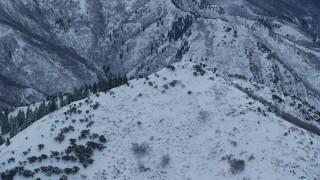 AX124_032 - 6K stock footage aerial video orbit summit of Grandeur Peak at Sunrise in Utah
