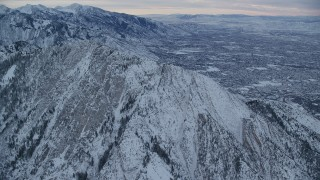 AX124_042 - 6K stock footage aerial video approach snowy Mount Olympus at winter sunrise in Wasatch Range, Utah