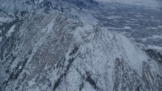 AX124_043 - 6K stock footage aerial video approach snow-covered Mount Olympus at Sunrise in Utah