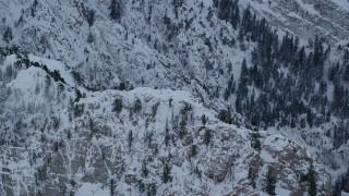 AX124_047 - 6K stock footage aerial video approach snowy summit of Mount Olympus at winter sunrise, Utah