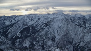 AX124_050 - 6K stock footage aerial video of sunrise over snowy mountains of the Wasatch Range in Utah