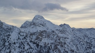 AX124_065 - 6K stock footage aerial video of O'Sullivan Peak with winter snow in the Wasatch Range at sunrise in Utah