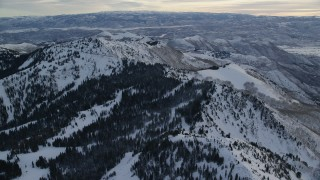 AX124_082 - 6K stock footage aerial video approach Mount Wolverine with winter snow at sunrise, Utah
