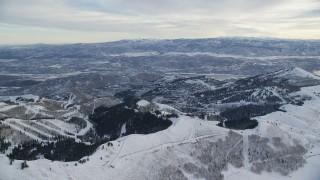 AX124_088 - 6K stock footage aerial video orbit Deer Valley Ski Resort in Park City at sunrise in winter, Utah