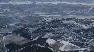 AX124_089 - 6K stock footage aerial video orbit Deer Valley Ski Resort with winter snow at sunrise, Utah