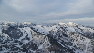 AX124_094 - 6K stock footage aerial video of upscale Park City homes and a snowy ridge in winter at sunrise in Utah