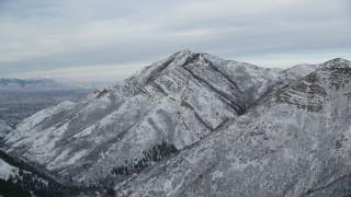 AX124_166 - 6K stock footage aerial video approach Grandeur Peak with winter snow at sunrise in Utah
