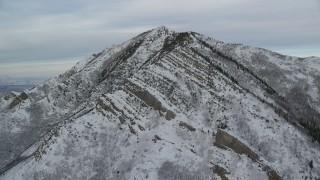 AX124_169 - 6K stock footage aerial video approach Grandeur Peak with light snow at sunrise in Utah