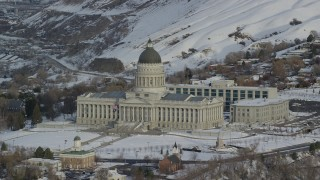 AX124_198 - 6K stock footage aerial video of Utah State Capitol with winter snow at sunrise in Salt Lake City