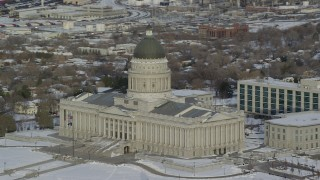 AX124_199 - 6K stock footage aerial video orbit the Utah State Capitol building with winter snow at sunrise in Salt Lake City