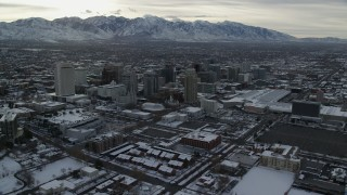 AX124_205 - 6K stock footage aerial video orbit Downtown Salt Lake City and Salt Lake Temple with snow at sunrise, Utah