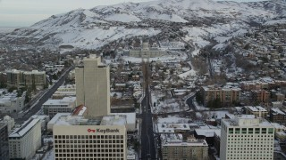 AX124_216 - 6K stock footage aerial video approach Utah State Capitol from Downtown in winter at sunrise, Salt Lake City