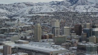 AX124_227 - 6K stock footage aerial video of Downtown Salt Lake City and Utah State Capitol with winter snow at sunrise
