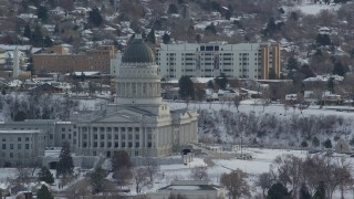 AX124_230 - 6K stock footage aerial video orbit of the Utah State Capitol in wintery Salt Lake City at sunrise