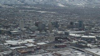 AX125_005 - 6K stock footage aerial video of panning across Downtown Salt Lake City with winter snow, Utah