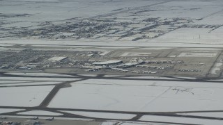 AX125_008 - 6K stock footage aerial video of Salt Lake City International Airport with winter snow, Utah