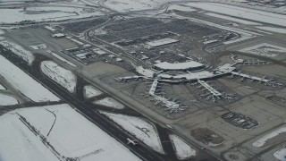 AX125_014 - 6K stock footage aerial video of Salt Lake City International Airport terminals with winter snow in Utah