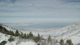 AX125_156 - 6K stock footage aerial video of the Oquirrh Mountains and a view of Great Salt Lake, Utah