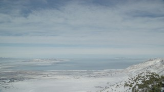 AX125_158 - 6K stock footage aerial video of Great Salt Lake seen from Oquirrh Mountains in winter. Utah
