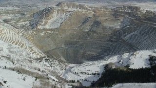 AX125_228 - 6K stock footage aerial video of approaching Bingham Canyon Mine with light winter snow, Utah
