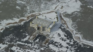 AX125_300 - 6K stock footage aerial video of circling the Saltair Pavilion with winter snow near Magna, Utah