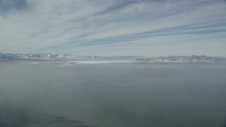AX125_306 - 6K stock footage aerial video of snow mountains on the shore of the Great Salt Lake in Utah