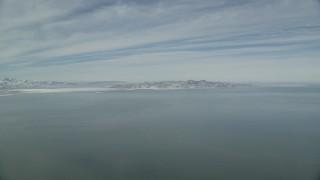 AX125_307 - 6K stock footage aerial video pan across Utah's Great Salt Lake in winter