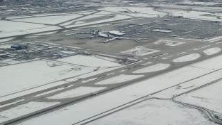 AX125_325 - 6K stock footage aerial video of tracking commercial jet on runway at SLC Airport with winter snow