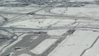 AX125_327 - 6K stock footage aerial video track airliner lifting off from SLC International Airport in winter, Utah