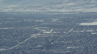 AX125_328 - 6K stock footage aerial video track airliner soaring over Salt Lake City in winter, Utah