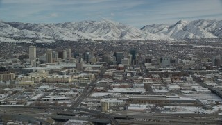 AX126_008 - 6K stock footage aerial video of the downtown area of Salt Lake City with winter snow in Utah