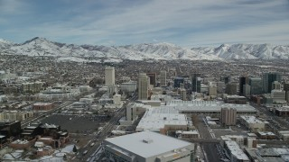AX126_012 - 6K stock footage aerial video orbit of snowy Downtown Salt Lake City, Utah, in winter