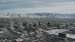AX126_013 - 6K stock footage aerial video orbit of Downtown Salt Lake City buildings with light winter snow, Utah