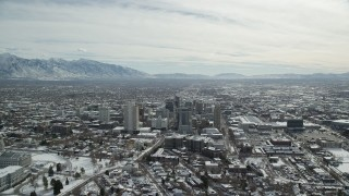 AX126_015 - 6K stock footage aerial video orbit Downtown Salt Lake City and reveal Utah State Capitol with winter snow