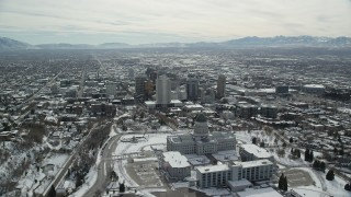 AX126_017 - 6K stock footage aerial video orbit of Utah State Capitol and Downtown Salt Lake City with snow in winter