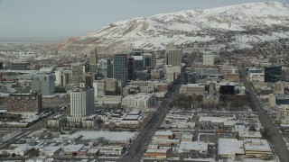 AX126_024 - 6K stock footage aerial video orbit south side of Downtown Salt Lake City with winter snow, Utah