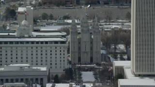 AX126_043 - 6K stock footage aerial video orbit the Salt Lake Temple in downtown with winter snow, Utah