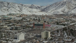 AX126_047 - 6K stock footage aerial video approach Rice-Eccles football stadium on the campus of University of Utah in winter, Salt Lake City
