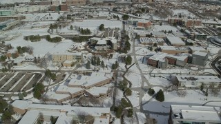 AX126_050 - 6K stock footage aerial video fly over snowy campus of the University of Utah, Salt Lake City