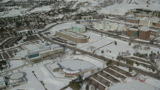 AX126_051 - 6K stock footage aerial video orbit baseball field and campus buildings with snow at University of Utah, Salt Lake City