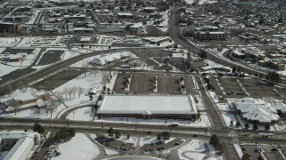AX126_059 - 6K stock footage aerial video fly over buildings with snow at the University of Utah and approach office buildings, Salt Lake City