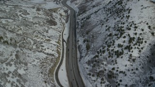 AX126_074 - 6K stock footage aerial video bird's eye view of Interstate 80 through the mountains and approach Mountain Dell Dam, Utah