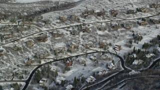 AX126_093 - 6K stock footage aerial video orbit mansions with winter snow in Park City, Utah